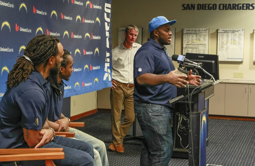 New Charger Brandon Mebane (right) speaks to press along with (from left) Dwight Lowrey, Travis Benjamin and Mike McCoy on Thursday at Charger park in San Diego, California.