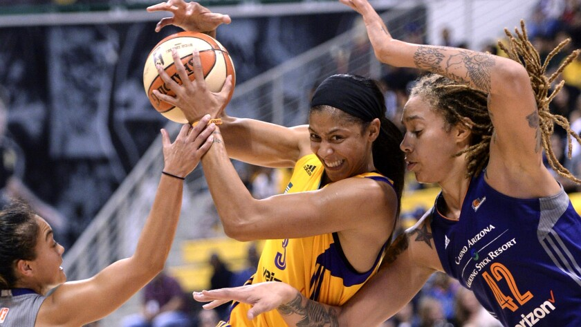 Los Angeles Sparks' Candace Parker (3) drives between Phoenix Mercury's Emma Cannon, left, and Britt