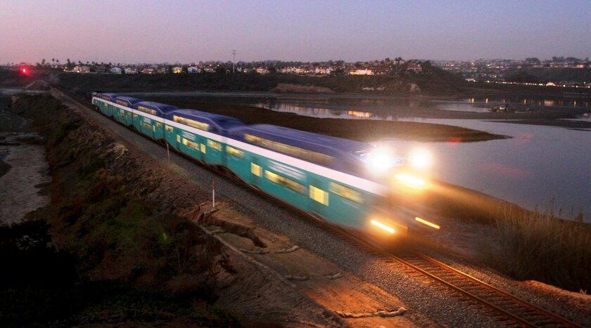 A northbound Coaster train crosses the Batiquitos Lagoon between Encinitas and Carlsbad.