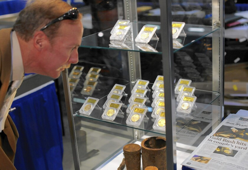Part of the Saddle Ridge hoard of gold coins found by a Northern California couple were displayed at the National Money Show in Marietta, Ga., on Feb. 27.