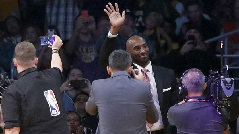 LOS ANGELES, CALIF. - OCT. 25, 2018. Lakers great Kobe Bryant waves to the crowd from a courtside se
