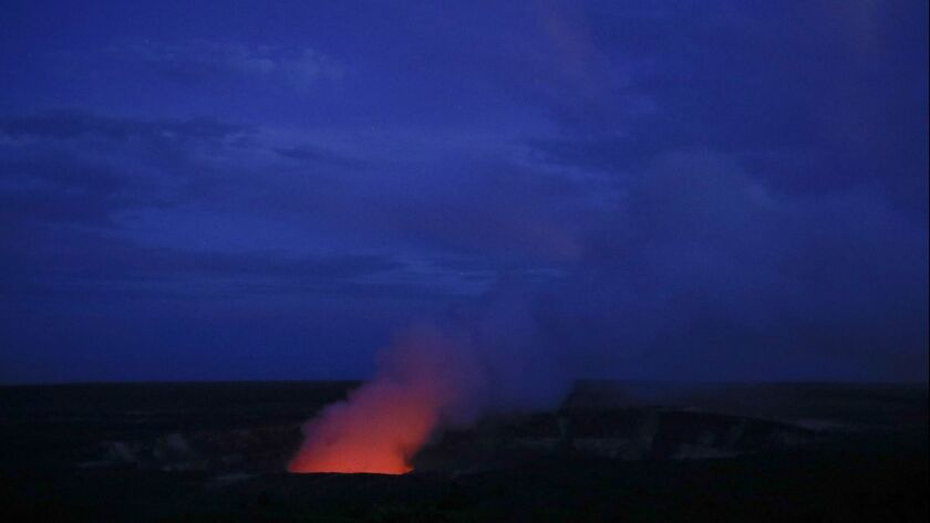 Kilauea's summit crater glows red in Volcanoes National Park, Hawaii on May 9.