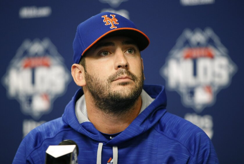 FILE - In this Sunday, Oct. 11, 2015 file photo, New York Mets Game 3 starting pitcher Matt Harvey listens to a reporter's question during a news conference, part of a National League Division Series baseball workout day in preparation for Monday's Game 3 against the Los Angeles Dodgers, at CitiFie