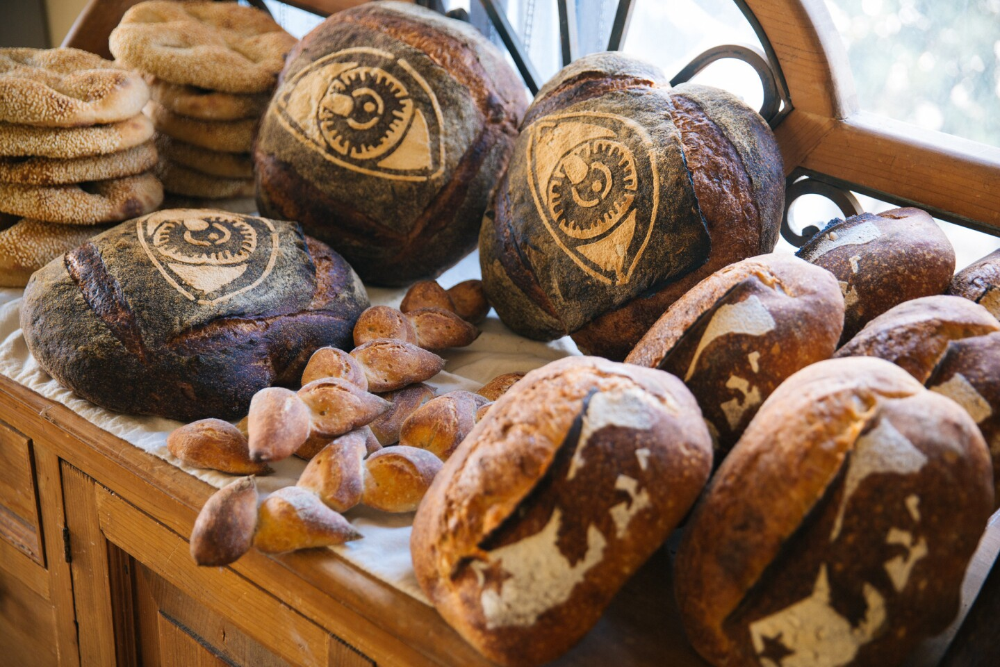 California loaves, epis, miches and seeded sand dollar breads at Gusto.