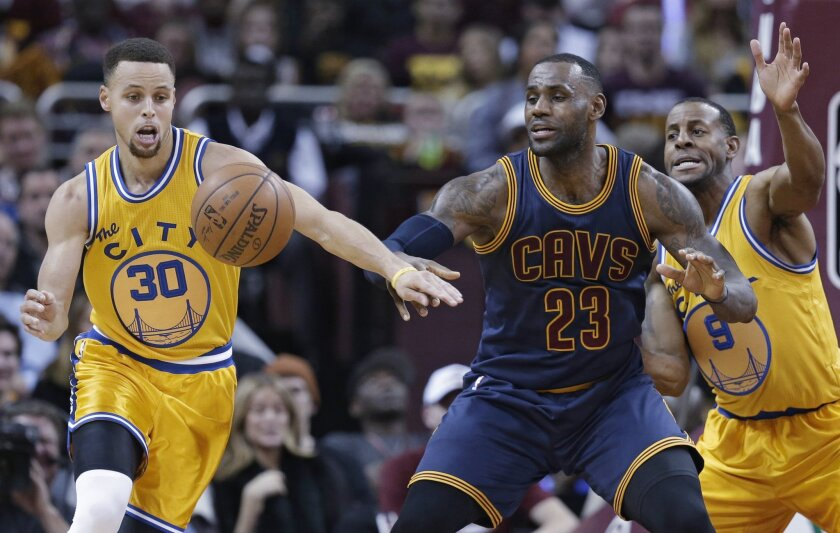 FILE - In this Jan. 18, 2016, filephoto, Golden State Warriors' Stephen Curry (30) knocks the ball loose from Cleveland Cavaliers' LeBron James (23) duriing the first half of an NBA basketball game in Cleveland. James knows there's no stopping Stephen Curry. The Cavaliers, healthier and better buil