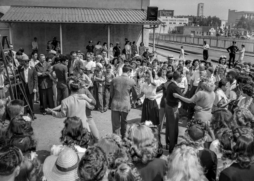 Aug. 11, 1943: Fans take to dancing while waiting for Frank Sinatra's train to arrive in Pasadena.