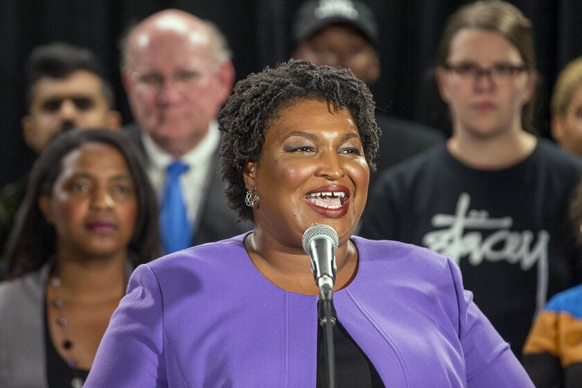 Georgia gubernatorial candidate Stacey Abrams told supporters she can't win the race, effectively ending her challenge to Republican Brian Kemp.