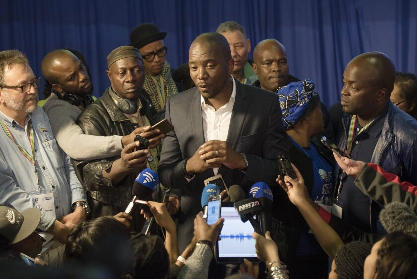 Mmusi Maimane, leader of the official opposition Democratic Alliance, talks to the press at the election results center in Pretoria, South Africa