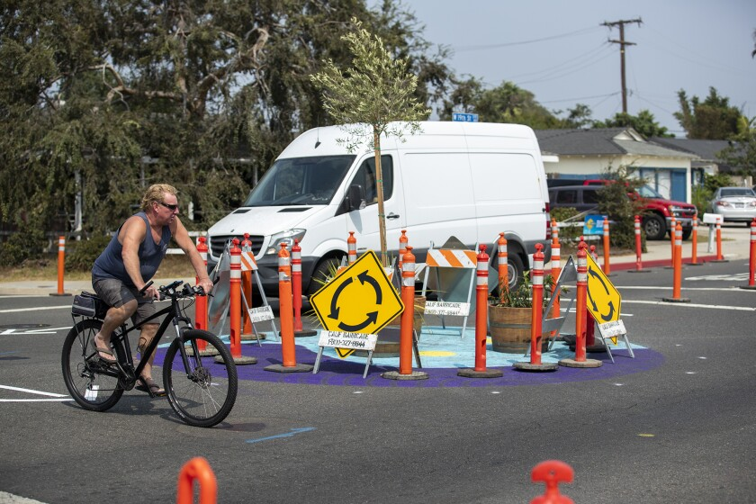 A bicyclist rides through an intersection at 19th St. and Monrovia Ave. in Costa Mesa