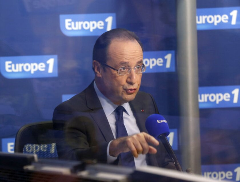 "French President François Hollande, shown during an interview Dec. 21 with Europe 1 radio station studio, lost a key element of his economic plan Saturday when France's Constitutional Council threw out his ""supertax"" on the wealthy."