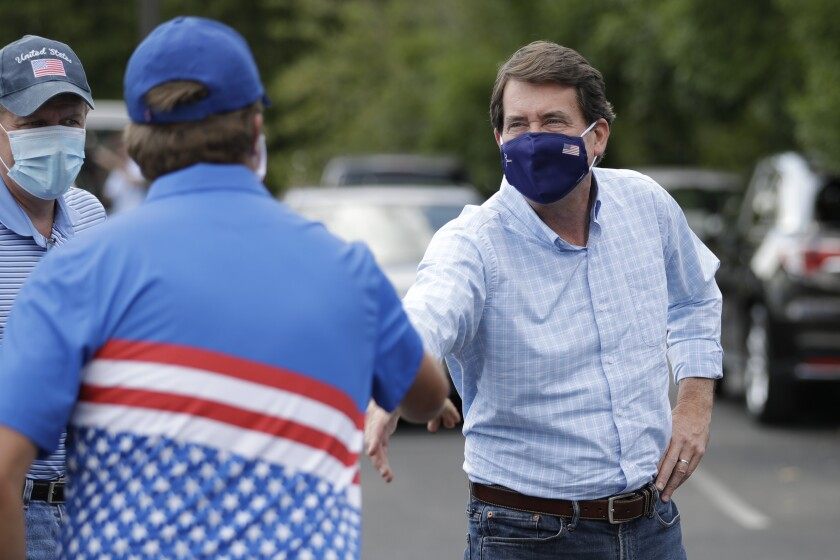 Former U.S. Ambassador to Japan Bill Hagerty greets supporters at a polling place Thursday in Brentwood, Tenn.