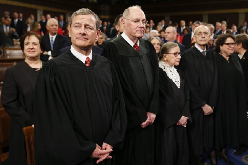 Chief Justice John G. Roberts Jr., front left, will be key to whether or not the Supreme Court can stand up to President Trump.