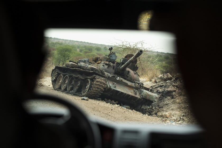 A destroyed tank is seen by the side of the road south of Humera, in an area of western Tigray annexed by the Amhara region during the ongoing conflict, in Ethiopia, Saturday, May 1, 2021. Ethiopia faces a growing crisis of ethnic nationalism that some fear could tear Africa's second most populous country apart, six months after the government launched a military operation in the Tigray region to capture its fugitive leaders. (AP Photo/Ben Curtis)
