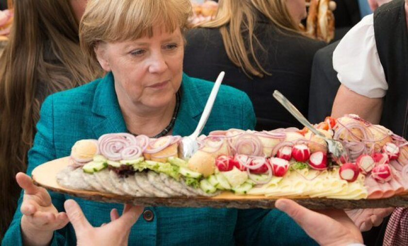 Chancellor Angela Merkel looks at a plate of sausage at a festival in Munich, Germany. Any beef on the plate might have been subject to regulations formerly expressed by the longest word in the German language.