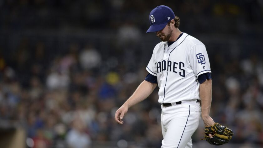 San Diego Padres relief pitcher Bryan Mitchell reacts as he walks back to the dugout after the top o