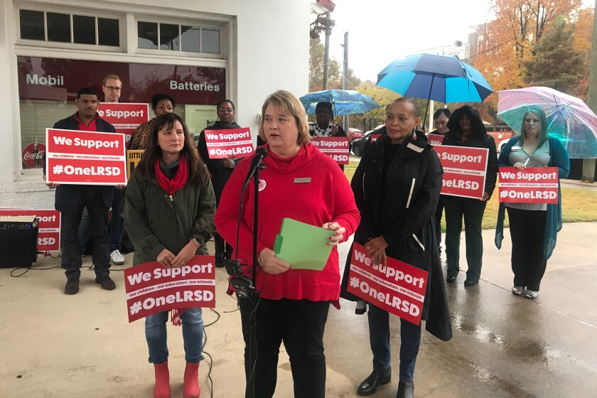 Teresa Knapp Gordon, president of the Little Rock Education Association, speaks at a news conference outside Little Rock Central High School in Little Rock, Arkansas on Monday, November 11, 2019. Gordon announced the association's members will strike for one day in response to the state stripping the union of its collective bargaining power and over Arkansas' control of the Little Rock School District. (AP Photo/Andrew Demillo)