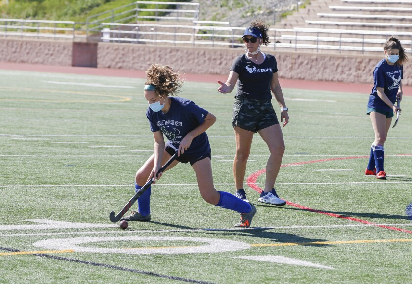 La Costa Canyon field hockey player Mia DiGiulio (left) works out as her mother, Kari DiGiulio (middle), does the coaching.