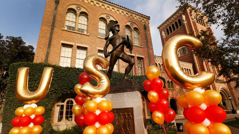 """Balloons spell out """"USC"""" in front of the Tommy Trojan statue on the university's campus."""