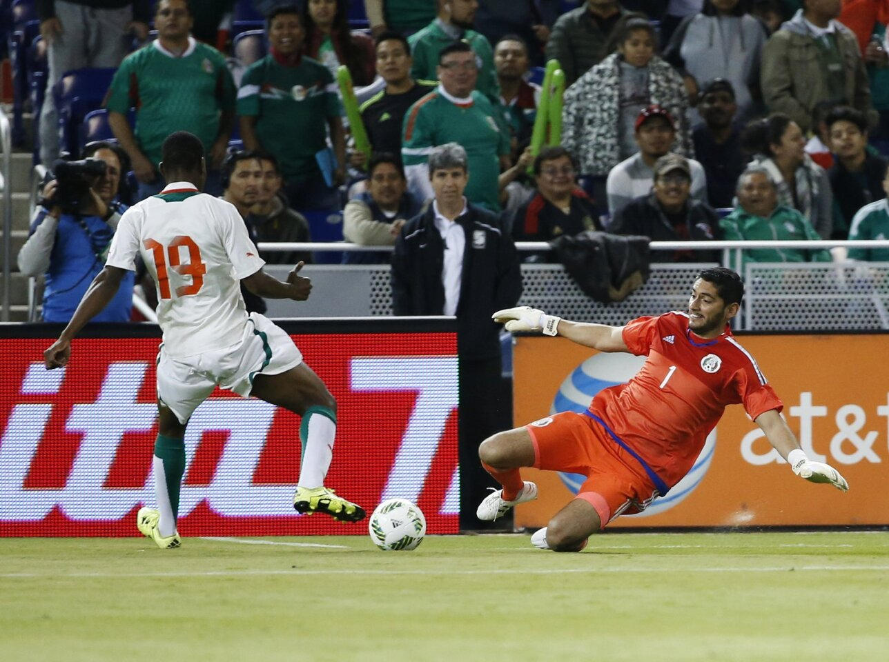 Mexico's goalkeeper Jesus Corona (1) makes a save against Senegal's Assane Mbodj during the first half of a soccer match at Marlins Park, Wednesday, Feb. 10, 2016, in Miami. (AP Photo/Wilfredo Lee)