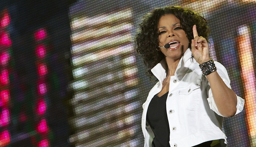 """FILE - In this Thursday, Oct. 13, 2011 file photo, American singer Janet Jackson, performs at Yas Island, Abu Dhabi, United Arab Emirates. Janet Jackson's entire ensemble she wore in the """"Scream"""" music video opposite of her brother Michael Jackson are among the items up for bid in a three-day auction, Saturday, May 15, 2021. (AP Photo/Nousha Salimi, File)"""