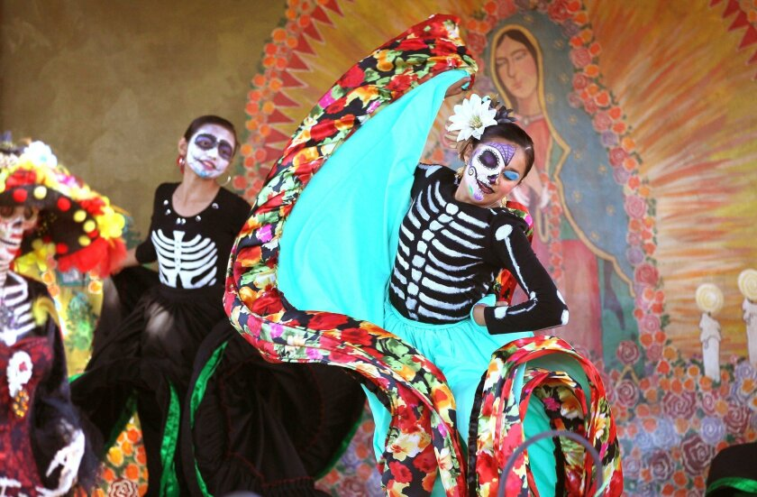 At the Dia de los Muertos celebration in Old Town dancers from Real de San Diego dance academy, of Chula Vista, perform at the Fiesta de Reyes plaza.