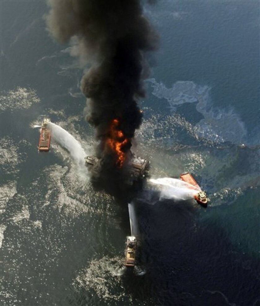 FILE - This April 21, 2010 file photo shows the Deepwater Horizon oil rig burning after an explosion in the Gulf of Mexico, off the southeast tip of Louisiana. Decisions intended to save time and money created an unreasonable amount of risk that triggered the largest offshore oil spill in U.S. history, a disaster that could happen again without significant reforms by industry and government, the presidential panel investigating the BP blowout concluded Wednesday, Jan. 5, 2011. (AP Photo/Gerald Herbert, File)