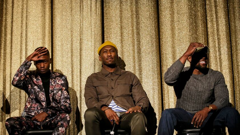 """""""Moonlight's"""" Mahershala Ali is flanked by Ashton Sanders, left, and Trevante Rhodes, two of the three actors who play the central character at different ages."""