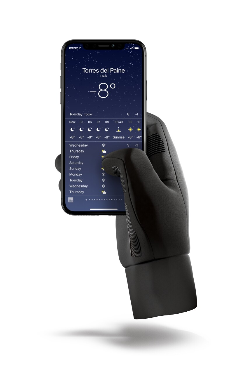 A black glove holding a smartphone with a weather reading of -8 degrees on the screen.
