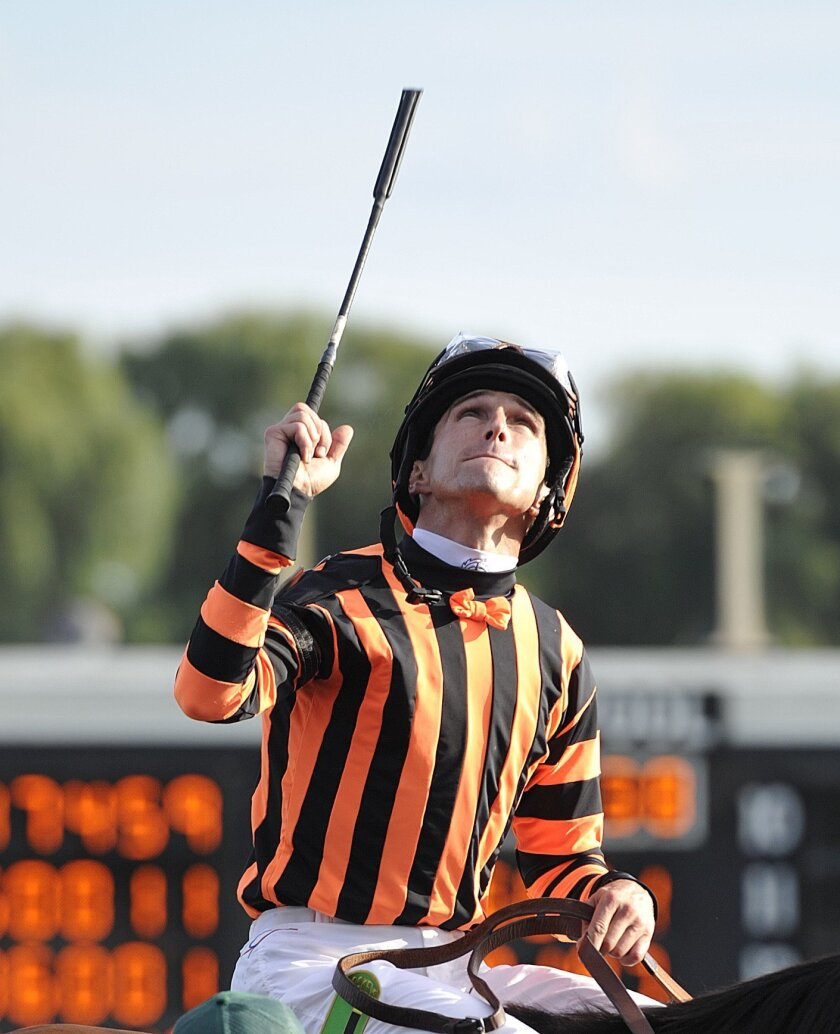 FILE - In this Aug. 18, 2012, file photo, jockey, Ramon A. Dominguez, celebrates aboard Little Mike after winning the Arlington Million horse race at Arlington Park in Arlington Heights, Ill. The National Museum of Racing and Hall of Fame will allow  Dominguez to become eligible this year for Hall