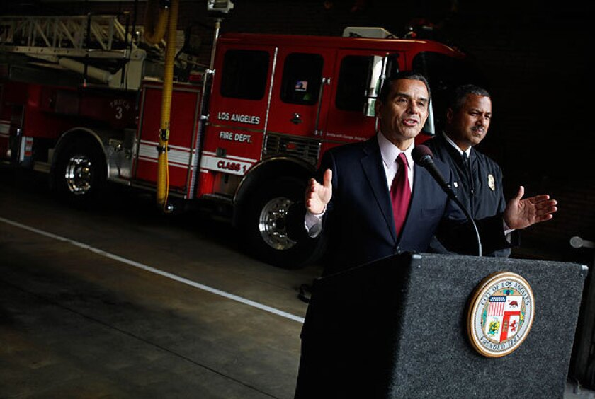 """Mayor Antonio Villaraigosa and Los Angeles Fire Department Chief Brian Cummings are shown during a news conference last month. Villaraigosa has ordered Cummings to reveal more data to the public, saying the department """"needs more transparency, not less."""""""