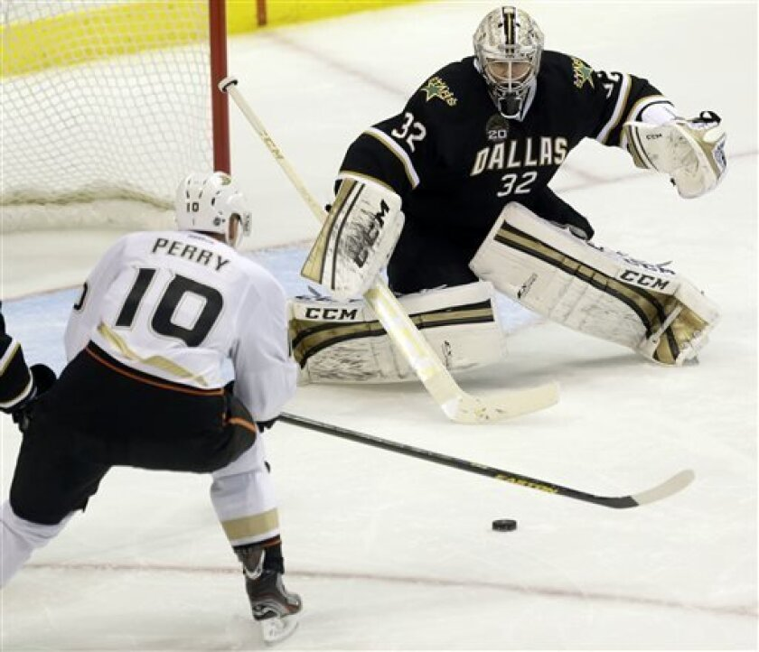 Anaheim Ducks forward Corey Perry (10) shoots for a goal against Dallas Stars goalie Kari Lehtonen (32), of Canada, during the second period of an NHL hockey game against the Dallas Stars in Dallas on Monday, April 1, 2013. (AP Photo/Mike Fuentes)