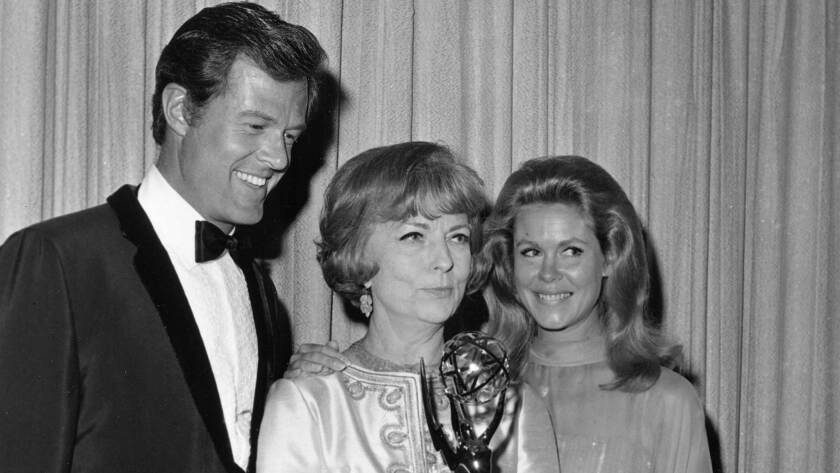 Actress Agnes Moorehead holds her Emmy award and poses with actor Robert Culp, left, and actress Elizabeth Montgomery.