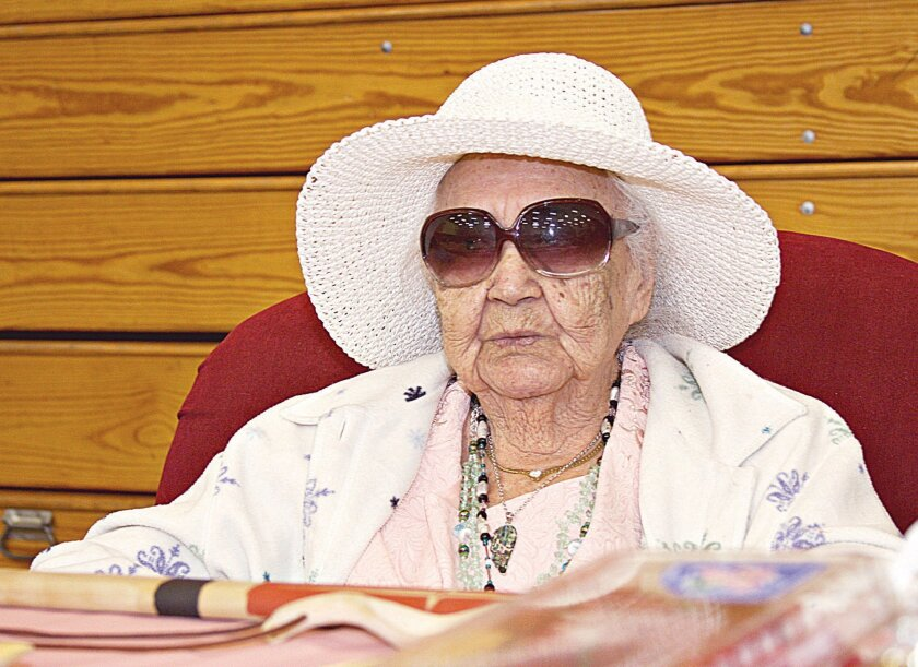 In a May 13, 2011 photo Hazel Sampson, a member of the Lower Elwha Klallam tribe, celebrates her 101st birthday at the tribal center near Port Angeles, Wash. Sampson who was the oldest member of the three Klallam tribes — Lower Elwha, Jamestown S'Klallam and Port Gamble — and the Klallam tribe in Beecher Bay, Canada, and the last to have spoken the Klallam language from birth, died on Tuesday, Feb 4, 2014. She was 103. (AP Photo, Tom Callis/Peninsula Daily News, Tomw Callis )