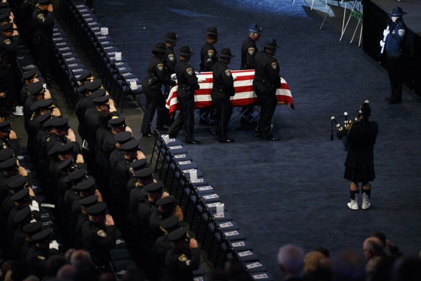 The casket of Sgt. Scott Lunger is carried to the stage during a memorial service for him at Oracle Arena in Oakland, Calif., Thursday, July 30, 2015. Lunger shot and killed during a traffic stop on July 22. (Dai Sugano/Bay Area News Group via AP) MANDATORY CREDIT