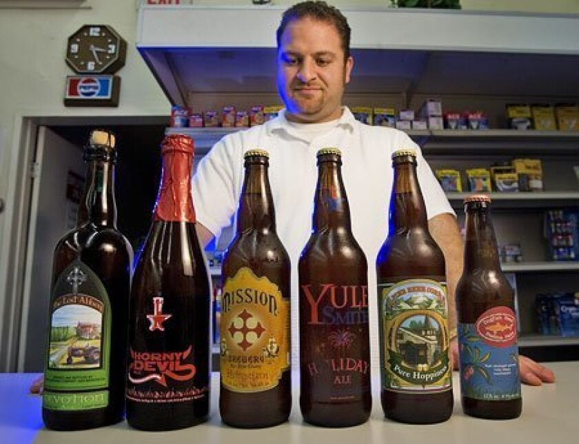 """George """"Joey"""" Bachoua of South Bay Drugs in Imperial Beach stocks 280 beers from around the world, including 75 chilled local brands. (Earnie Grafton / Union-Tribune)"""