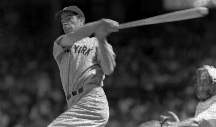 New York Yankees legend Joe DiMaggio lines a single to left field during a game against Washington in June 1941.