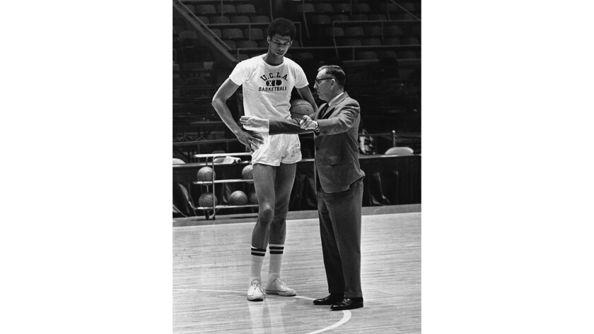 In 1969, Lew Alcindor — the future Kareem Abdul-Jabbar — with his UCLA coach, John Wooden.