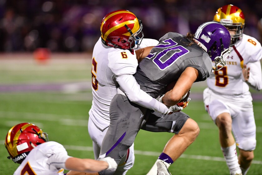 Torrey Pines triumphed over Carlsbad 31-24 in an Avocado League game on Oct. 20.