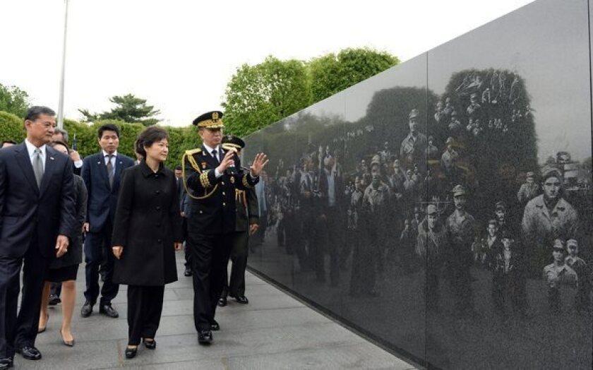 South Korean President Park Geun-hye tours the Korean War Veterans Memorial in Washington.