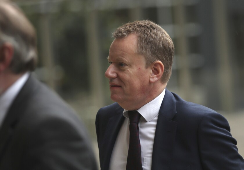 """FILE - In this file photo dated Wednesday, Oct. 16, 2019, United Kingdom's Brexit envoy David Frost arrives at EU headquarters in Brussels. Britain's chief Brexit negotiator Frost is quoted in a newspaper Sunday Sept. 6, 2020, saying Britain wants """"to get back the powers to control our borders and that is the most important thing"""", as he talks tough ahead of crucial Brexit trade talks, saying the U.K. was """"not afraid to walk away."""" (AP Photo/Francisco Seco, FILE)"""