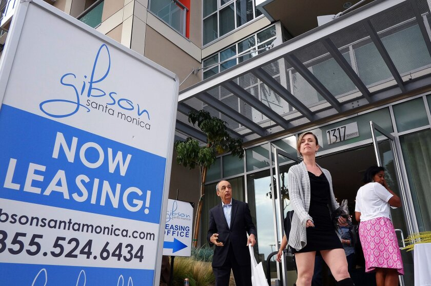 In this Wednesday, March 18, 2015 photo, visitors arrive for the grand opening of Gibson Santa Monica, a new luxury apartment complex in downtown Santa Monica, Calif. Residential rents, the biggest driver of inflation in 2015, climbed 3.5 percent in June from a year earlier, the fifth straight month with an annual gain of that size. (AP Photo/Richard Vogel)
