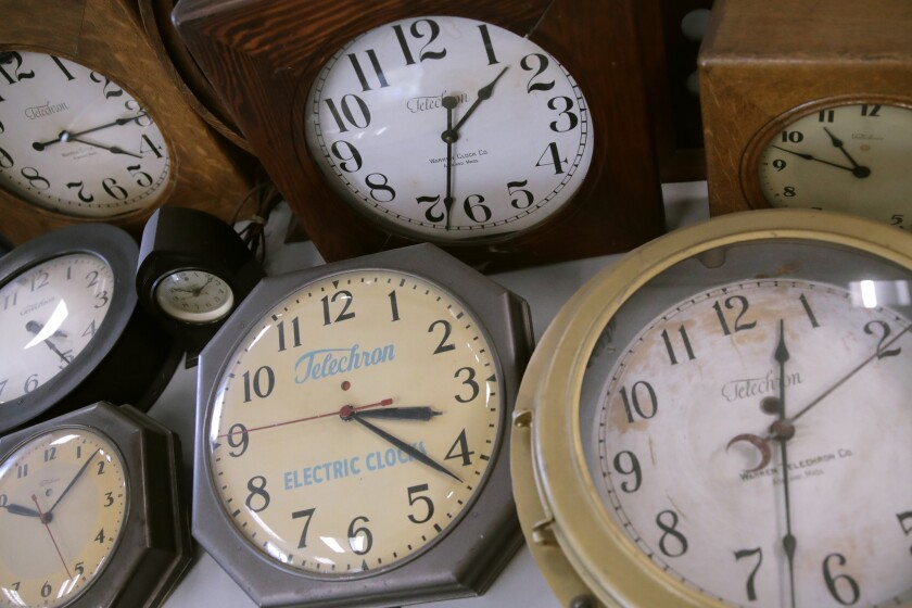 Antique clocks are displayed at the Electric Time Company, in Medfield, Massachusetts.