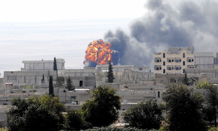 Smoke rises in the Syrian town of Kobani, during fighting against Islamic State militants.