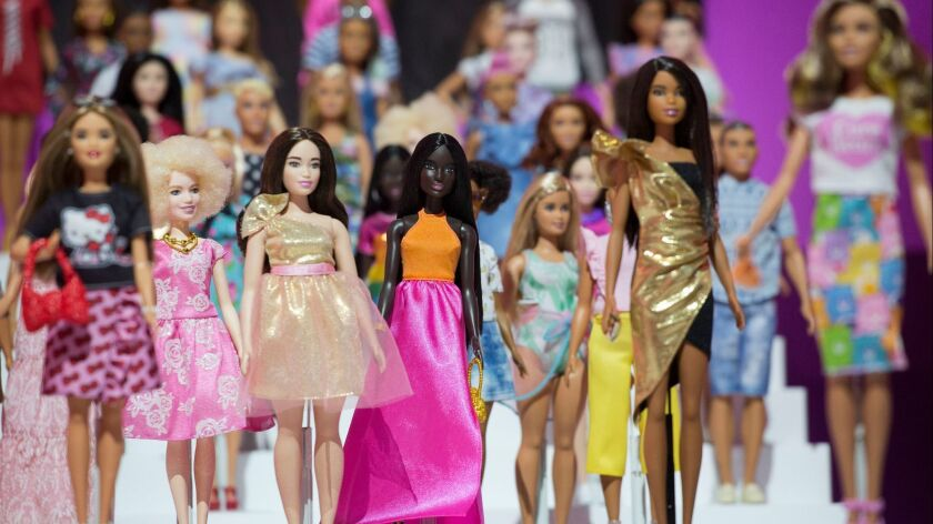 Dozens of Barbie dolls are displayed at the Mattel showroom at Toy Fair in New York in February.