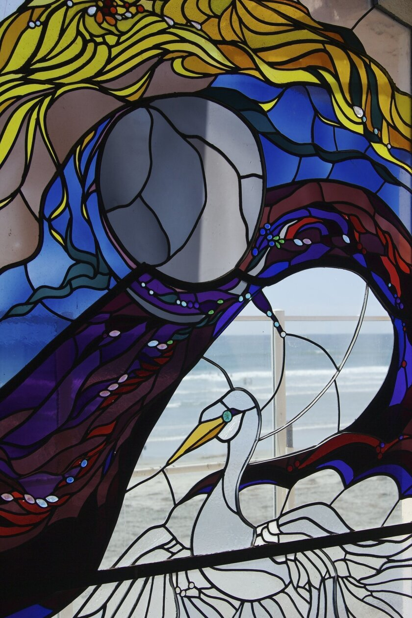 Detail of a stained glass artwork by James Hubbell that was removed last week from the now-closed Beach House restaurant in Cardiff. CREDIT: Courtesy photo