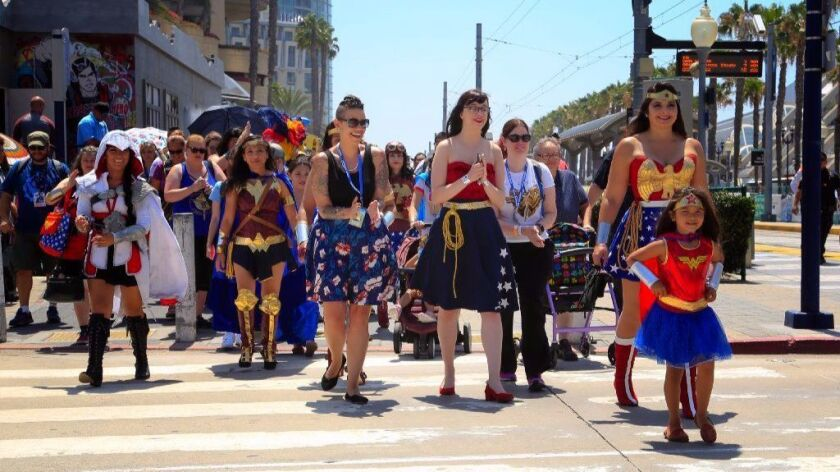 Convention attendees participate in a Wonder Woman parade around the Gaslamp Quarter during Comic-Con 2017 in San Diego.