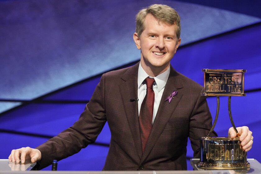 """This image released by ABS shows contestant Ken Jennings with a trophy on """"JEOPARDY! The Greatest of All Time."""" Jennings will be the first interim guest for the late Alex Trebek, and the show will try other guest hosts before naming a permanent replacement. (Eric McCandless/ABC via AP)"""