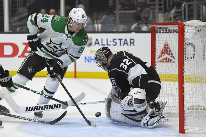 Kings goaltender Jonathan Quick stops a shot from Stars left wing Roope Hintz during the first period of a game Jan. 8 at Staples Center.