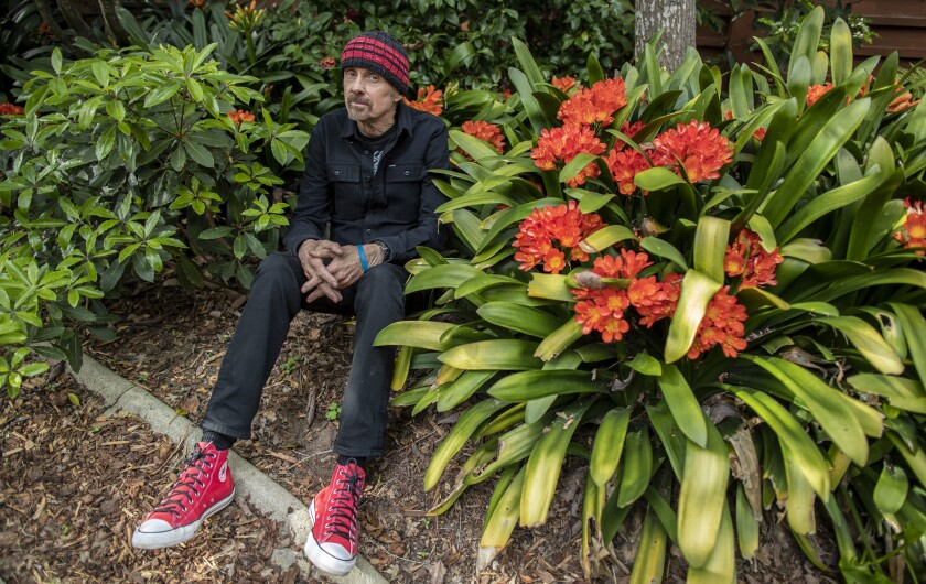 Novelist T. C. Boyle in the garden among blooming Clivia outside his Frank Lloyd Wright-designed home in Montecito, Calif., on March 26, 2019.