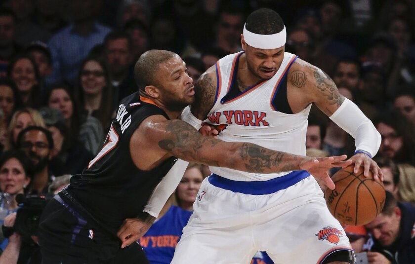 Phoenix Suns forward P.J. Tucker, left, tries to strip the ball from New York Knicks forward Carmelo Anthony during the first quarter of an NBA basketball game Friday, Jan. 29, 2016, in New York. (AP Photo/Julie Jacobson)